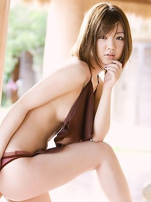 Asami Tani Asian with big naughty hooters has hot photo session