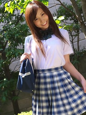 Schoolgirl Iyo Hanak poses at the open air in sexy skirt