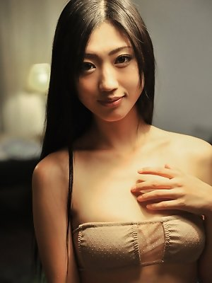 Mitsu Dan Asian with long hair examines hot behind in the mirror