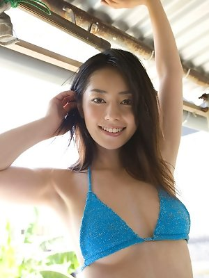 Sexy petite gravure idol in a sensuous green flowing dress