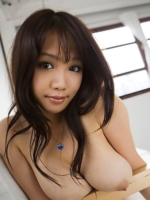 Lovely Asian chick poses and shows off her firm tits and ass to tease cocks