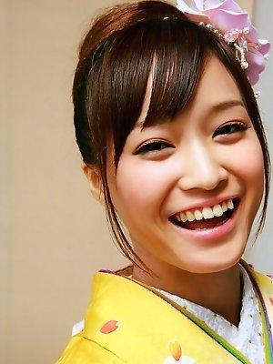 Beautiful gravure idol dressed in a bright and colorful kimono