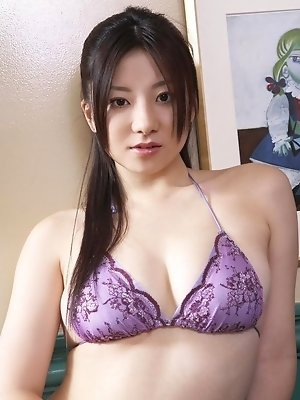 Cute gravure idol poses beautifully in her cotton lingerie